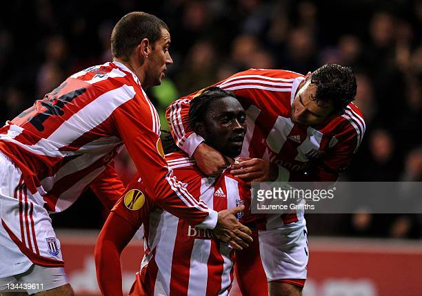 Kenwyne Jones of Stoke City celebrates scoring his team's first goal with team mates Rory Delap and Danny Higginbotham during the UEFA Europa League...