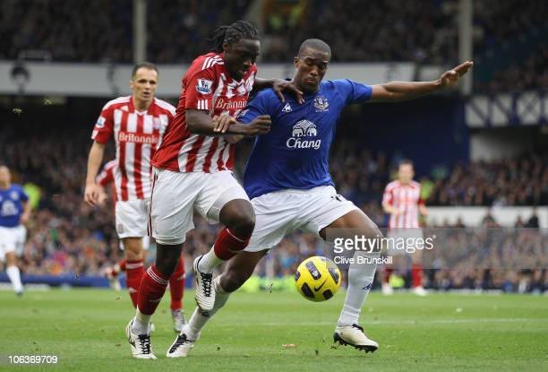 Kenwyne Jones of Stoke City in action with Sylvain Distin of Everton during the Barclays Premier League match between Everton and Stoke City at...
