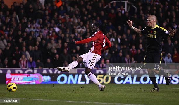 Kenwyne Jones of Stoke City scores the second goal as Martin Skrtel of Liverpool looks on during the Barclays Premier League match between Stoke City...