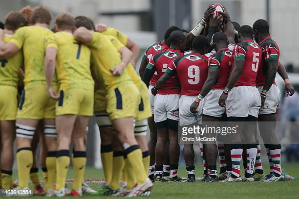 Kenya and Australia players go into team huddles before the start of the match between and Kenya and Australia during day two of the Tokyo Sevens...