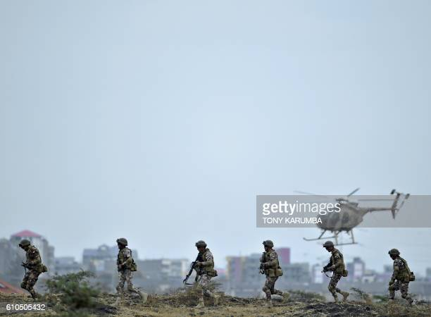 TOPSHOT Kenya Defence Forces and Royal Jordanian Armed Forces take part in a combat simulation on September 26 2016 during the closing of...