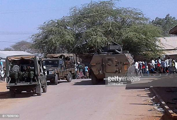 Kenya Defence Forces soldiers arrive at the scene of a bomb attack claimed by Shabaab militants in the northeastern town of Mandera Northern Kenya A...