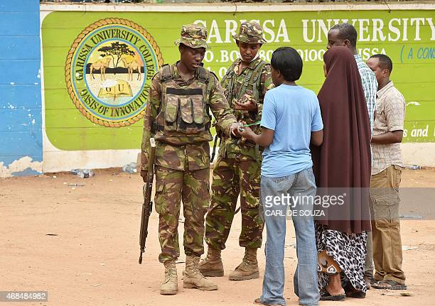Kenya Defence forces soldiers search and question people at the front entrance of Moi University in Garissa on April 3, 2015. Kenya's interior...