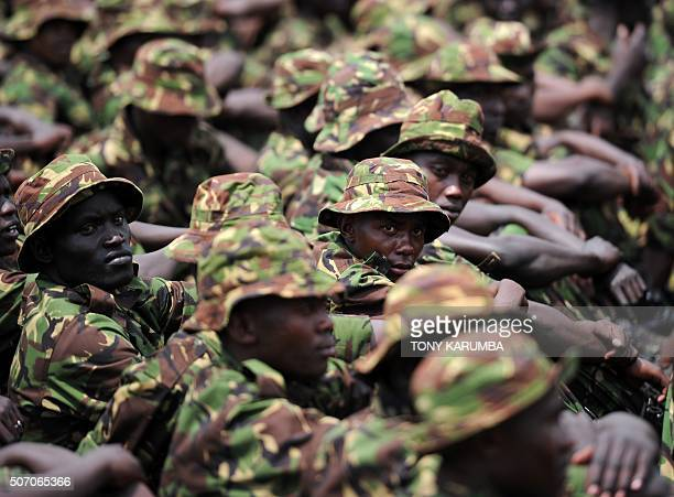Kenya Defence Forces soldiers wait to listen to a speech by the Kenyan president at the Moi Barracks in Eldoret approximately 326 kms northeast of...