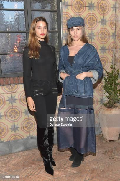 Kenya KinskiJones and Lana Zakocela attend Saks Fifth Avenue X Attico Dinner at AOC Wine Bar on April 11 2018 in Los Angeles California
