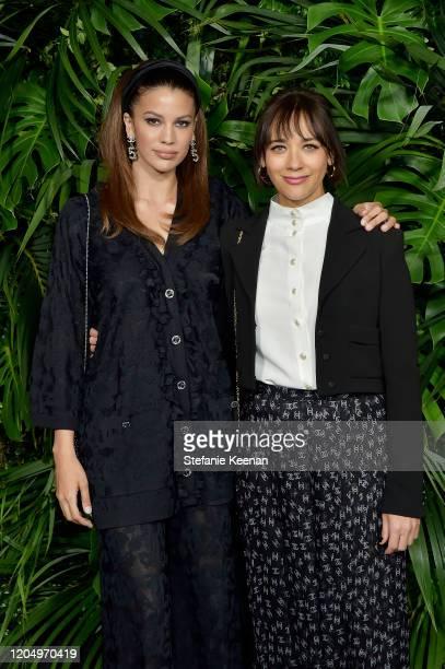 Kenya KinskiJones and Rashida Jones both wearing CHANEL attends CHANEL and Charles Finch PreOscar Awards Dinner at Polo Lounge at The Beverly Hills...