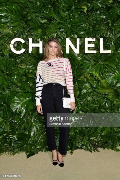 Kenya KinskiJoneswearing CHANEL attends Chanel Dinner Celebrating Gabrielle Chanel Essence With Margot Robbie on September 12 2019 in Los Angeles...
