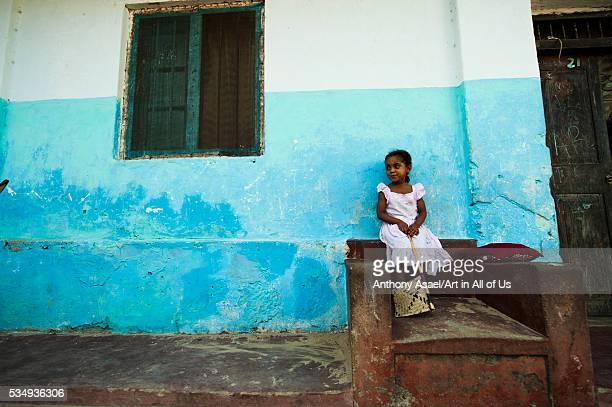 Kenya Lamu archipelago Lamu little girl in front of her house