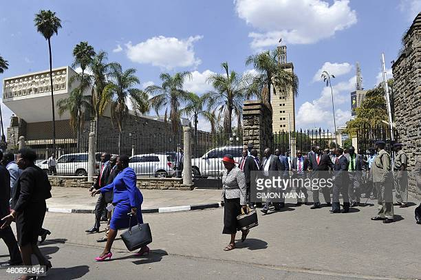 Kenya lawmakers leave the building during a break on December 18 2014 in Nairobi after debating on the controversial new security legislation that...