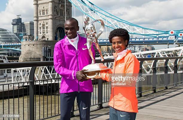 Kenya men's winner Eliud Kipchoge and Ethiopian women's winner Tigist Tufa pose during a photocall after winning the London Marathon at the Tower...