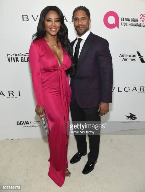 Kenya Moore and Marc Daly attend the 26th annual Elton John AIDS Foundation's Academy Awards Viewing Party at The City of West Hollywood Park on...