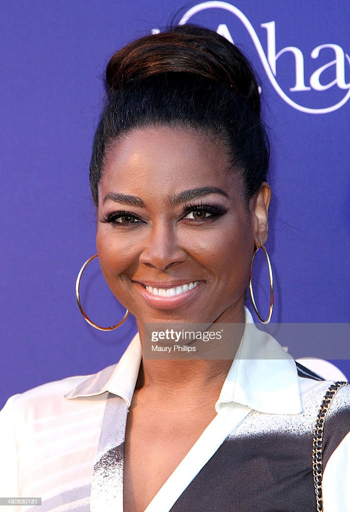 Kenya Moore arrives at 'L.A. Hair' Season 3 premiere party at Kimble Hair Studio and Extension Bar on May 21, 2014 in Los Angeles, California.