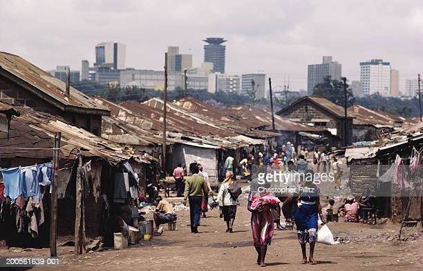 Kenya, Nairobi, Mathahare valley slums, skyscrapers in background