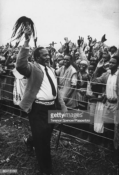 Kenya Nationalist leader Jomo Kenyatta returning to his home after being imprisoned