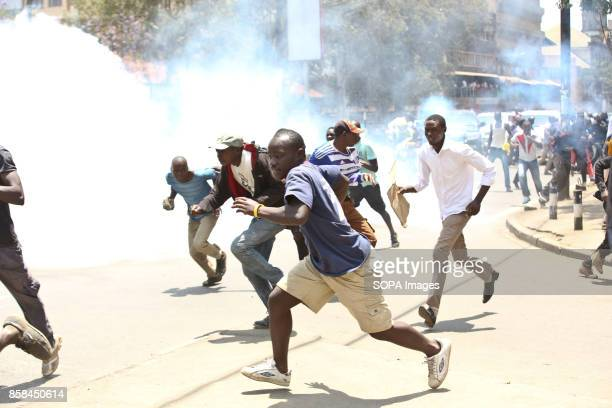 Kenya Opposition supporters run as the antriot police tear gas them on the Nairobi streets Kenyan opposition under the coalition National Supper...