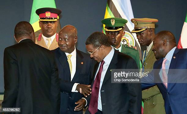 Kenya President Uhuru Kenyatta Uganda President Yoweri Museveni Tanzania President Jakaya Kikwete and Burundi President Pierre Nkurunziza greet one...