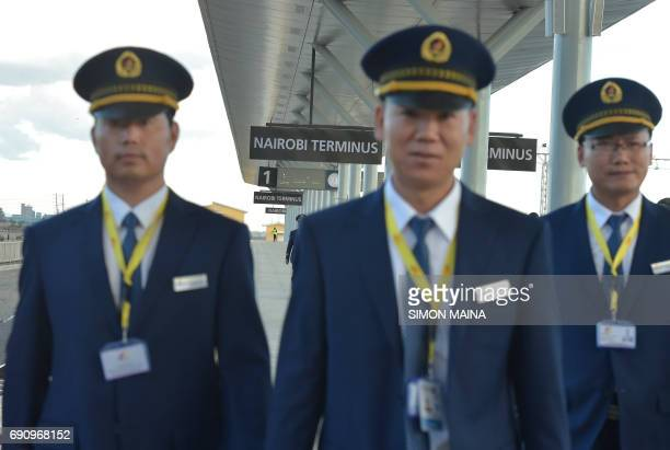 Kenya Railways attendants from China upon arrival from Mombasa in a train launched to operate on the Standard Gauge Railway on May 31 2017 in Nairobi...