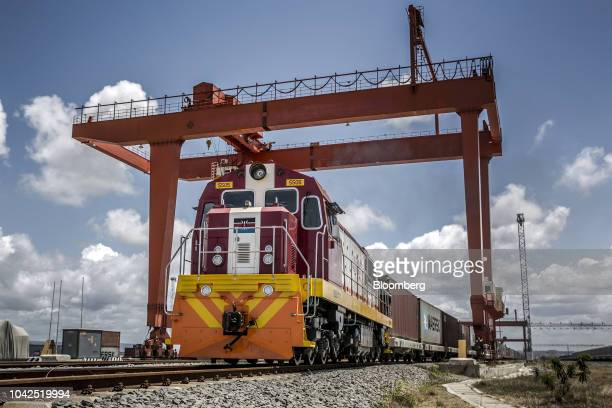 A Kenya Railways CorpCorp freight train pulls shipping containers as it departs from the port station on the MombasaNairobi Standard Gauge Railway...