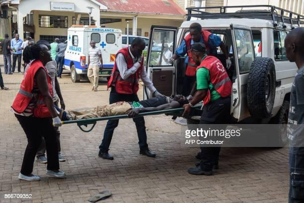 Kenya Red Cross paramedics brings a wounded man into Jaramogi Oginga Odinga Referral Hospital in the opposition stronghold of Kisumu western Kenya on...