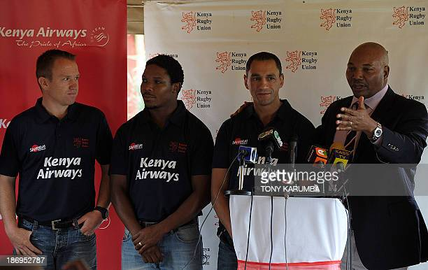 Kenya Rugby Union's chairman, Mwangi Muthee presents the new coach for the national rugby union sevens team, South Africa's Paul Treu alongside...