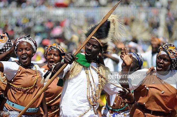 Kenya traditional dancers perfoming as they waslk past the presidential dias at Nyayo national stadium in Nairobi on December 12 2012 during Jamhuri...