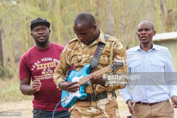 Kenya Wildlife Service game ranger entertains guests during this year's World Wildlife Day celebrations at Lake Nakuru National Park