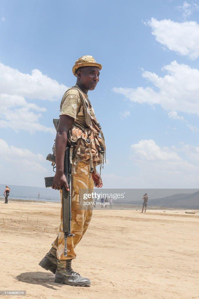 Kenya Wildlife Service game ranger  is seen watching over... : News Photo