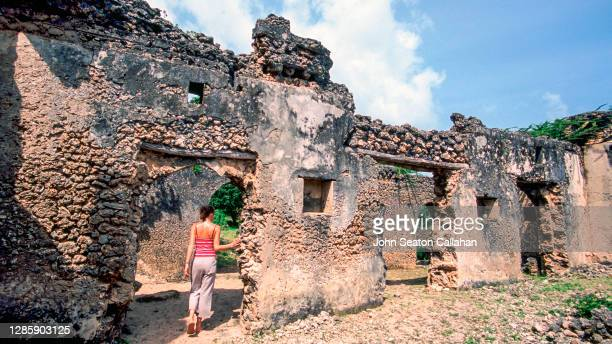 kenya, woman exploring takwa on manda island - mombasa stock pictures, royalty-free photos & images