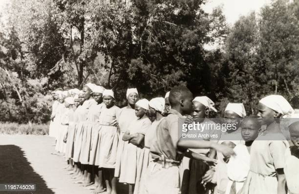 Kenya Young Kikuyu women are lined up outdoors at a Church of Scotland mission school Original manuscript caption At the mission school the girls are...