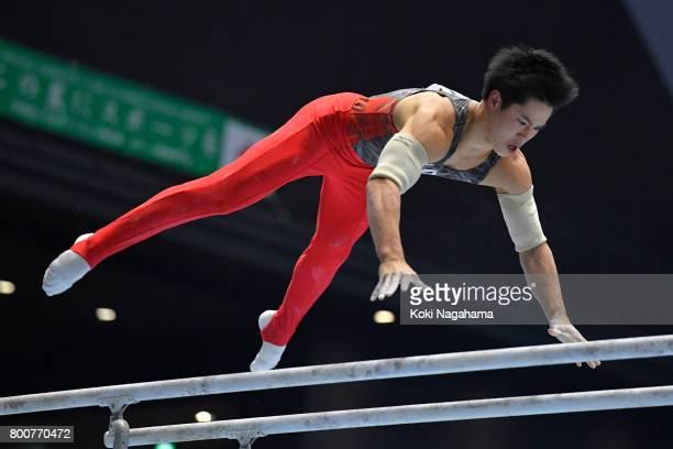 Kenya Yuasa competes in the Parallel Barsduring Japan National Gymnastics Apparatus Championships at the Takasaki Arena on June 25 2017 in Takasaki...