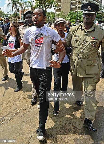 Kenyan activist Boniface Mwangi is arrested during a demonstration against Members of Parliament who have demanded higher wages outside Pariliament...