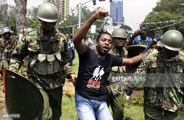Kenyan activist Boniface Mwangi is arrested during a protest in Nairobi on February 13 2014 The demonstration entitled State of the Nation was held...