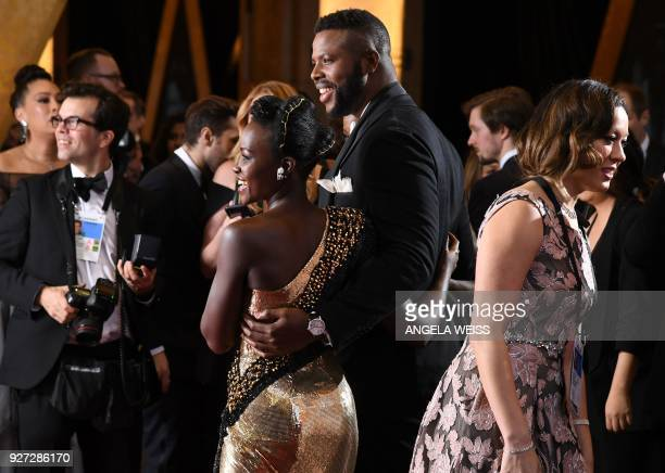 Kenyan actress Lupita Nyong'o and Trinidadian actor Winston Duke arrive for the 90th Annual Academy Awards on March 4 in Hollywood California / AFP...