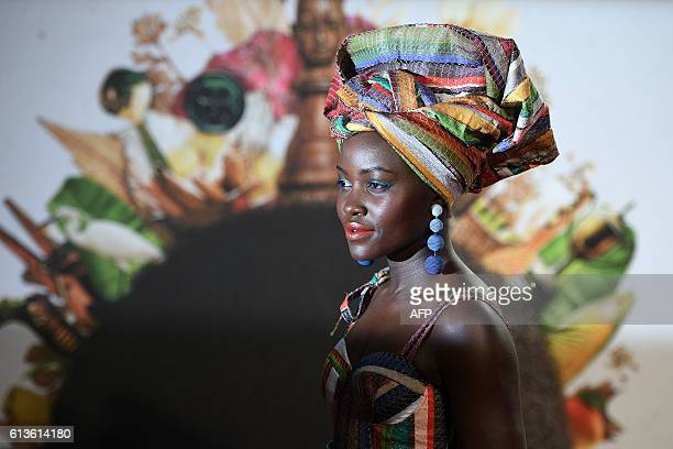 Kenyan actress Lupita Nyong'o poses on the red carpet after arriving to attend a gala screening of the film 'Queen of Katwe' during the BFI London...