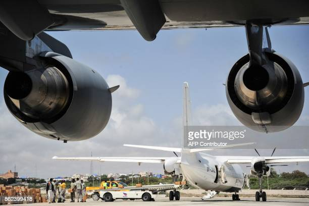 A Kenyan aircraft waits to evacuate Somalian severely wounded by the latest truck bomb attack in Mogadishu at Aden Adde international airport in...