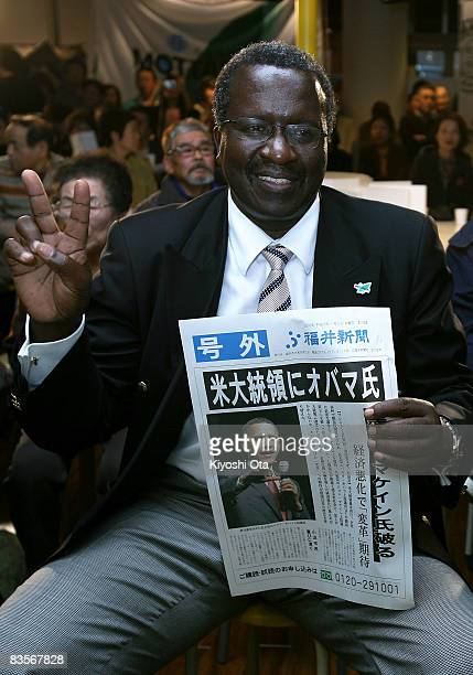 Kenyan Ambassador to Japan Dennis Noel Oduya Awori poses with an extra edition reporting the Democratic presidential candidate US Sen Barack Obama...