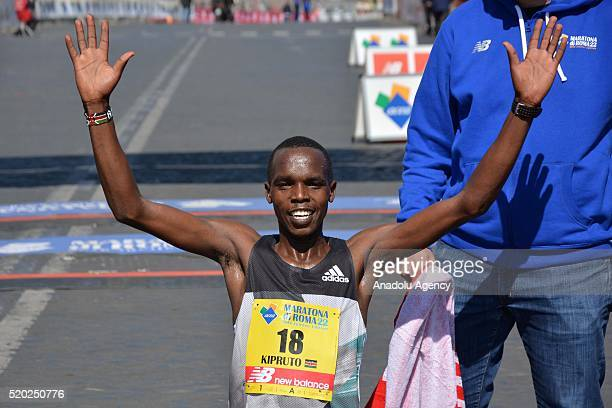 Kenyan Amos Kipruto celebrates as he wins the 22nd Marathon of Rome in Italy on April 10 2016 Sixteen thousand runners from 115 countries take part...