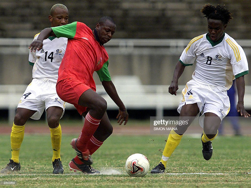 Kenyan andrew oyombe c tries to tackle pictures getty images kenyan andrew oyombe c tries to tackle south african manpoba ngwenya r negle Choice Image
