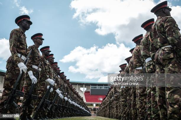 TOPSHOT Kenyan army soldiers perform during the rehearsal of the inauguration ceremony of the President at the Moi International Sports Center's...