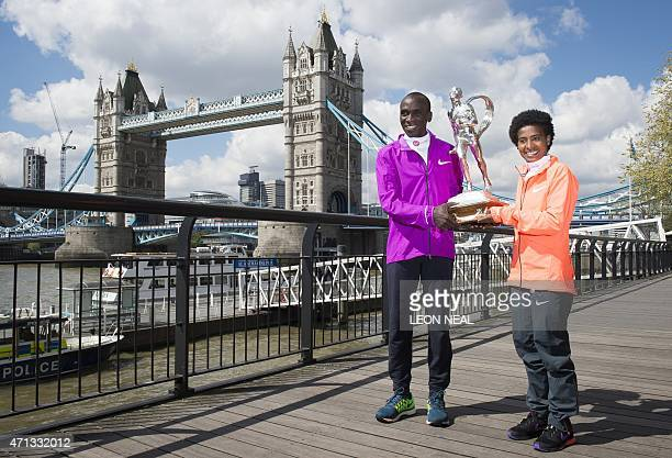 Kenyan athlete Eliud Kipchoge and Ethiopian athlete Tigist Tufa pose for pictures during a photocall for the winners of the 2015 London Marathon in...