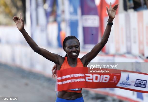 Kenyan athlete Ruth Chepngetich celebrates after competing in women's race during the 'Vodafone 40th Istanbul Marathon' held in Istanbul Turkey on...