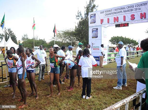 Kenyan athletes stand at the finish line after competing in the senior women's category on February 13 2016 in the IAAF permit/National Cross Country...