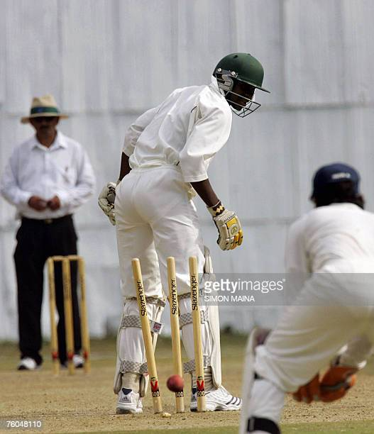 Kenyan batsman Lameck Onyango looks back as he is bowled out by India A bowler Pankaj Singh 10 August 2007 during their threeday match at Mombasa...