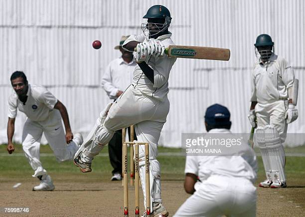 Kenyan batsman Peter Ongondo hocks a delievery from India's bowler Irfan Pathan as India's wicket keeper Parthiv Patel awaits a catch 07 August 2007...