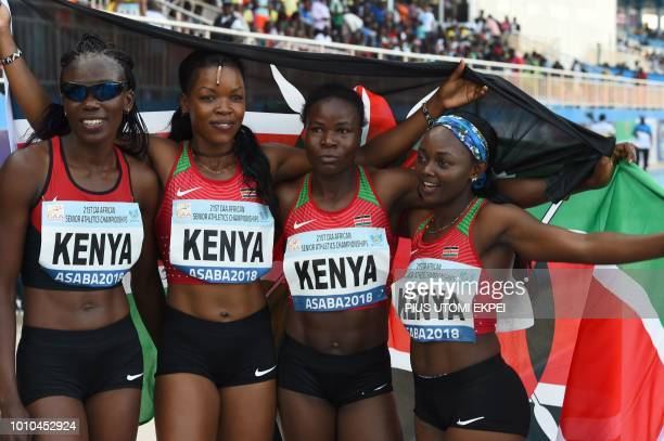 Kenyan bronze medalists Eunice Kadogo Fresha Mwangi Joan Cherono celebrate after competing in the women's 4x100m relay during the 21st African Senior...