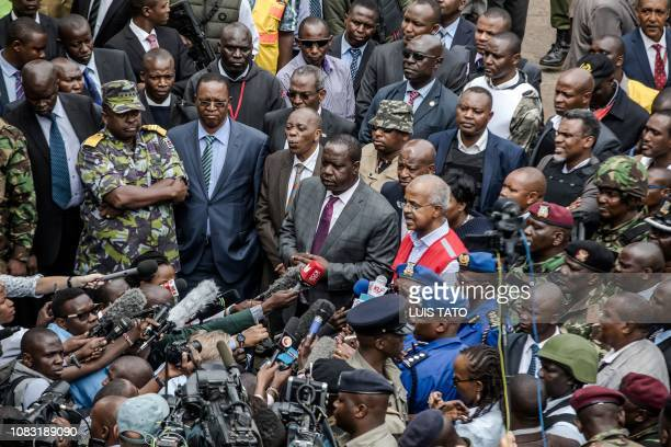 TOPSHOT Kenyan Cabinet Secretary for Internal Security Fred Okengo Matiang'i speaks to the press upon his arrival on the scene of the terrorist...