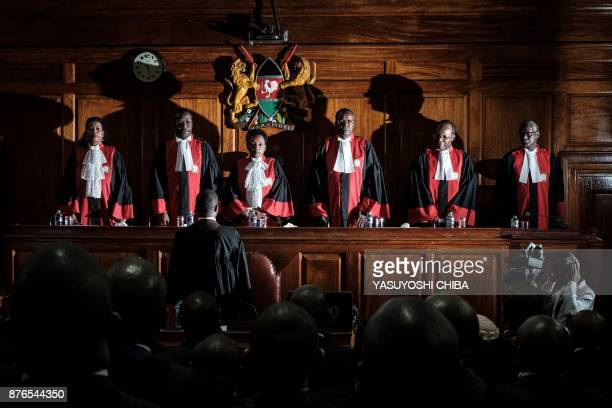 TOPSHOT Kenyan Chief Justice David Maraga and judges stand prior to speak as the Kenya's Supreme Court on November 20 2017 dismissed two petitions to...