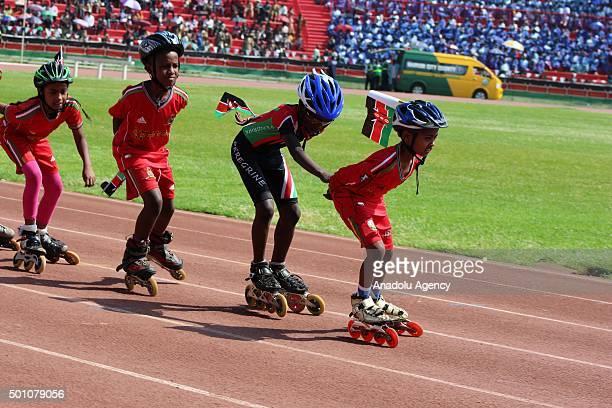 Kenyan children skate during the celebrations of Jamhuri Day at Nyayo National Stadium in Nairobi Kenya on December 12 2015 Jamhuri Day is celebrated...