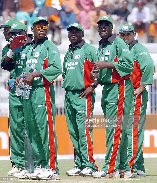 Kenyan cricket captain Stephen Tikolo looks on as he waits with teammates for a run out decision against Bangladeshi batsman Shahriar Nafees during...
