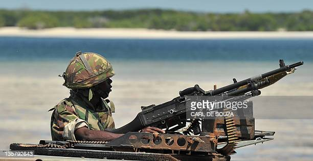 A Kenyan Defence Force soldier keeps lookout on the coast near Burgabo village Southern Somalia on December 14 2011 Burgabo is a Somalian port...